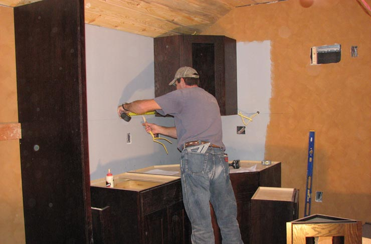 Installing cabinets in GN 441's kitchen
