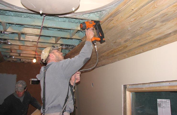 Nailing the blue pine ceiling